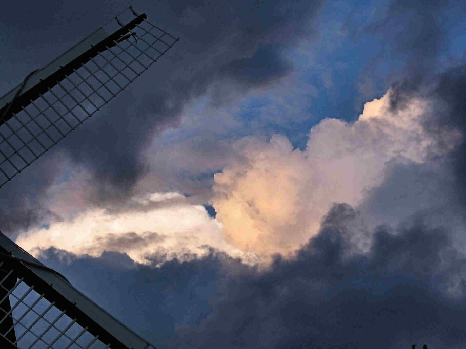 Rather dramatic clouds through the wings of Lumsaas Mill